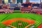 Crews make last minute preparations to the field at Busch Stadium before the start of the NLDS.