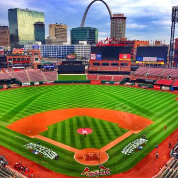 Crews make last minute preparations to the field before the start of the NLDS
